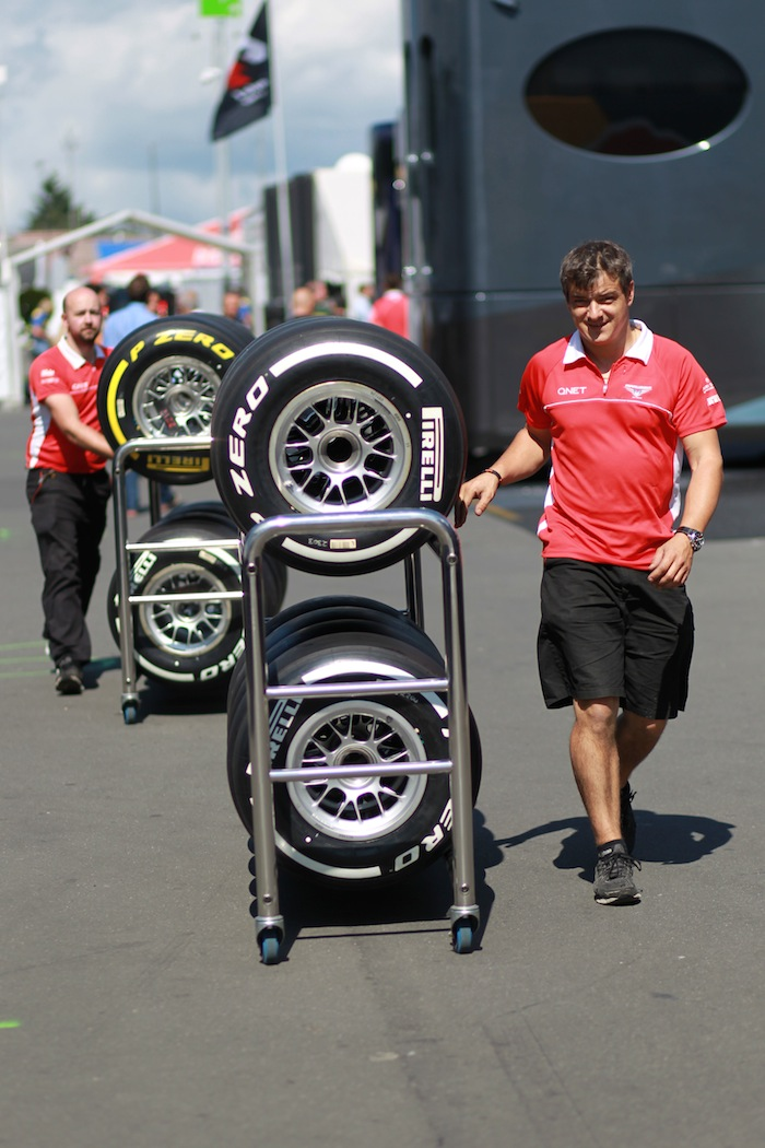 Soft-and-medium-tyres-being-handled-by-team-personnel
