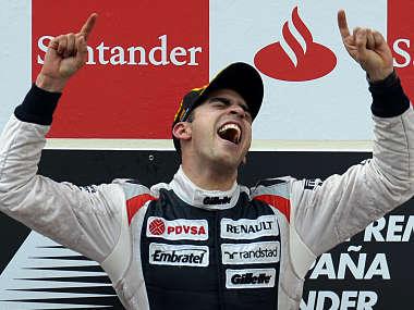 Williams Formula One driver Pastor Maldonado of Venezuela celebrates on the podium after his victory in the Spanish F1 Grand Prix in Montmelo